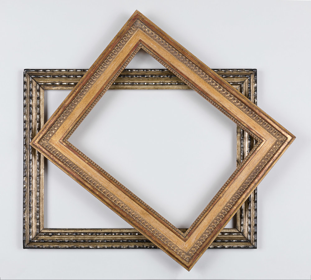 Two picture frames, stacked decoratively