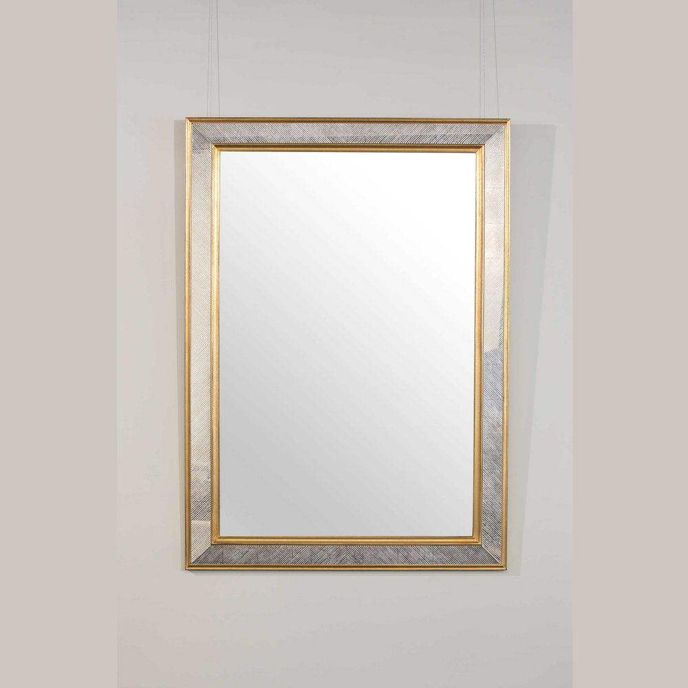 Gold and silver framed mirror hanging on wall