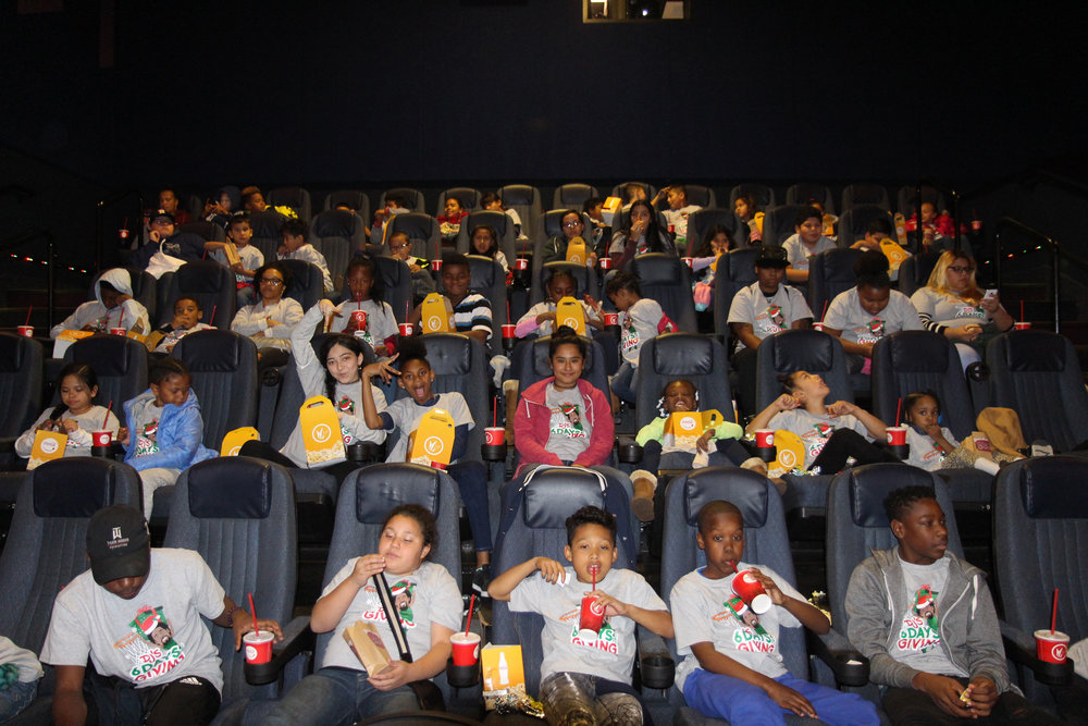 Day 3 - DJ treated a group of 60 kids to a private viewing of a children's holiday movie