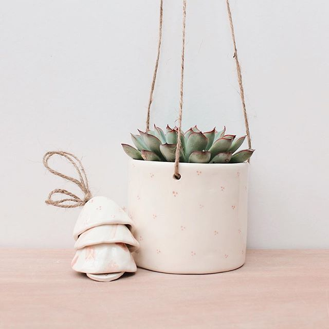 Happy Easter everyone!  I've been a little quiet lately as I've moved house and moved jobs. It's been a lot all at once and I've been feeling a little overwhelmed but I'm going off on holiday soon so a break will be very much needed!  I'll leave you with one of my favourite photos of my pink spotted hanging pot and bell stack