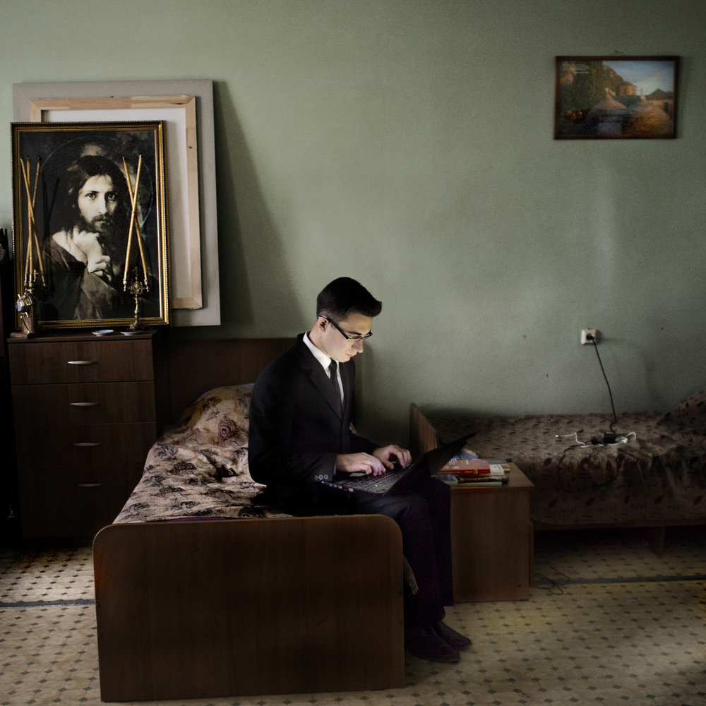 An aspiring priest studying in his room at the priest seminary in Kazan.