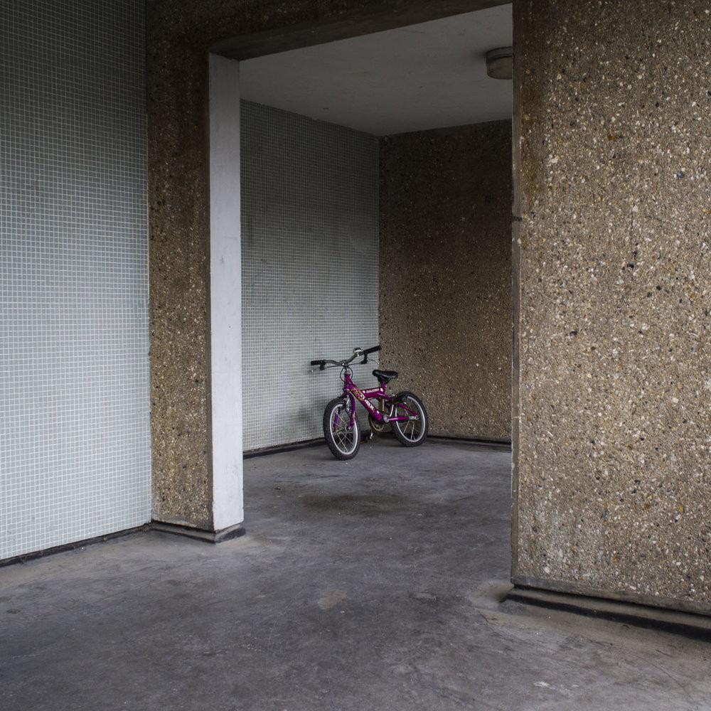 Bike left on the walkway.