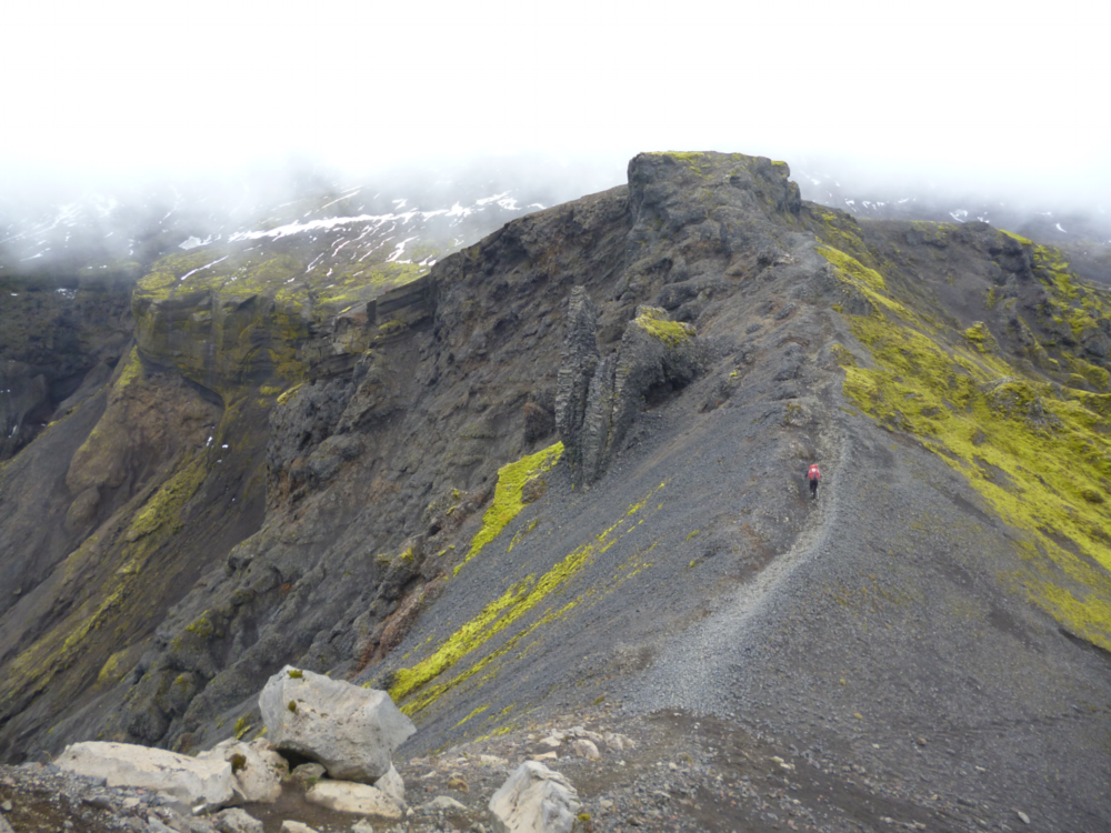 As the Fimmvorduhals Trail ascends from Thorsmork, it begins to pass between two active volcanoes: the Eyjafjallajökull and Katla, each with their own glacial ice cap.