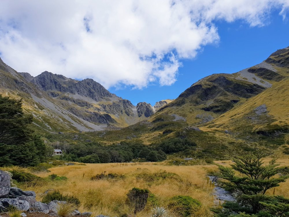 Upper Travers Hut is perhaps one of the best huts on the hike, nestled below the surrounding mountains.