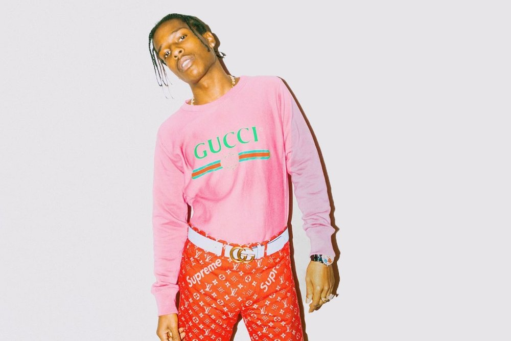 @asaprocky poses in Supreme x Louis Vuitton pants and Gucci apparel