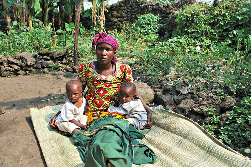 Anastasie and her children Claude and Claudette in her award-winning garden in Kimonyi.
