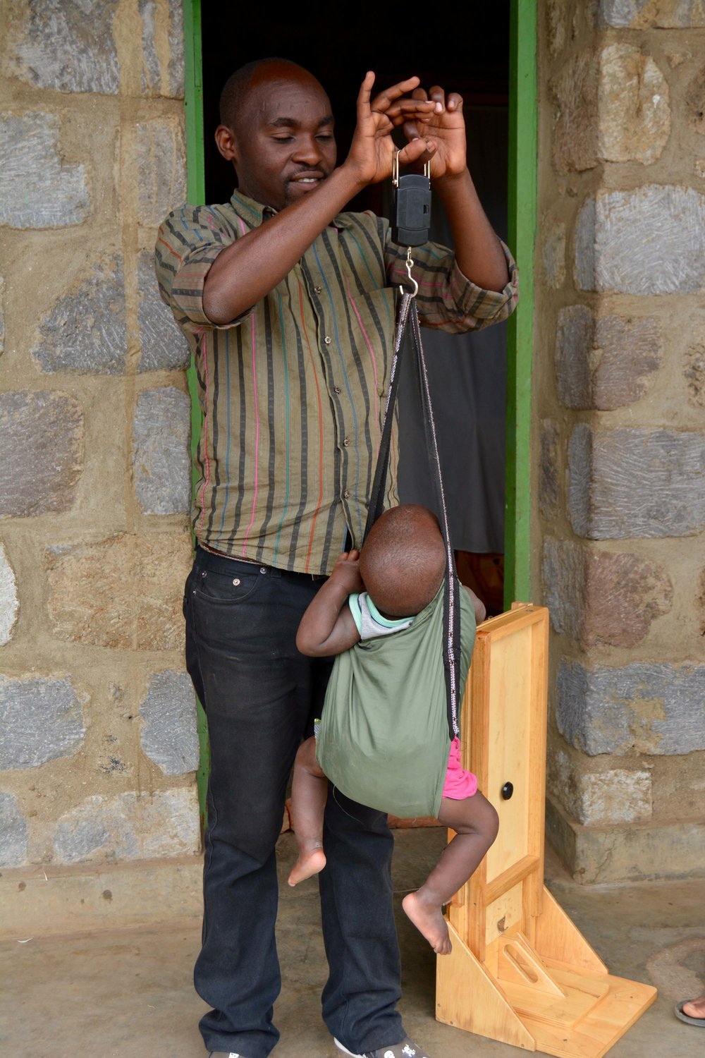 Monitoring and Evaluation agent Donation helps weigh children.