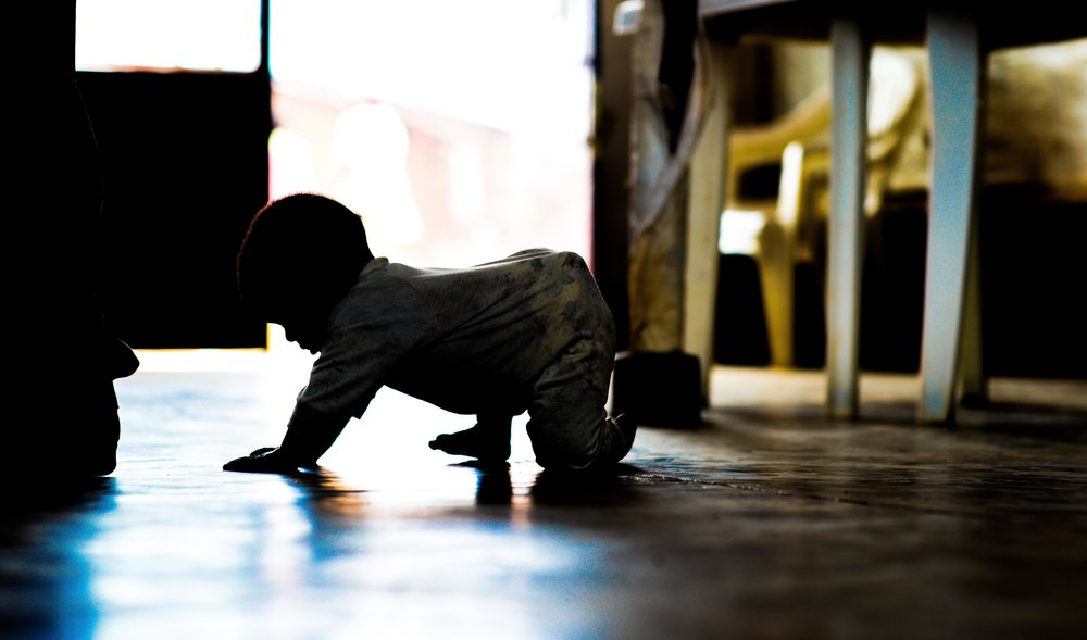 A child crawls during an agriculture training at Mahama refugee camp.