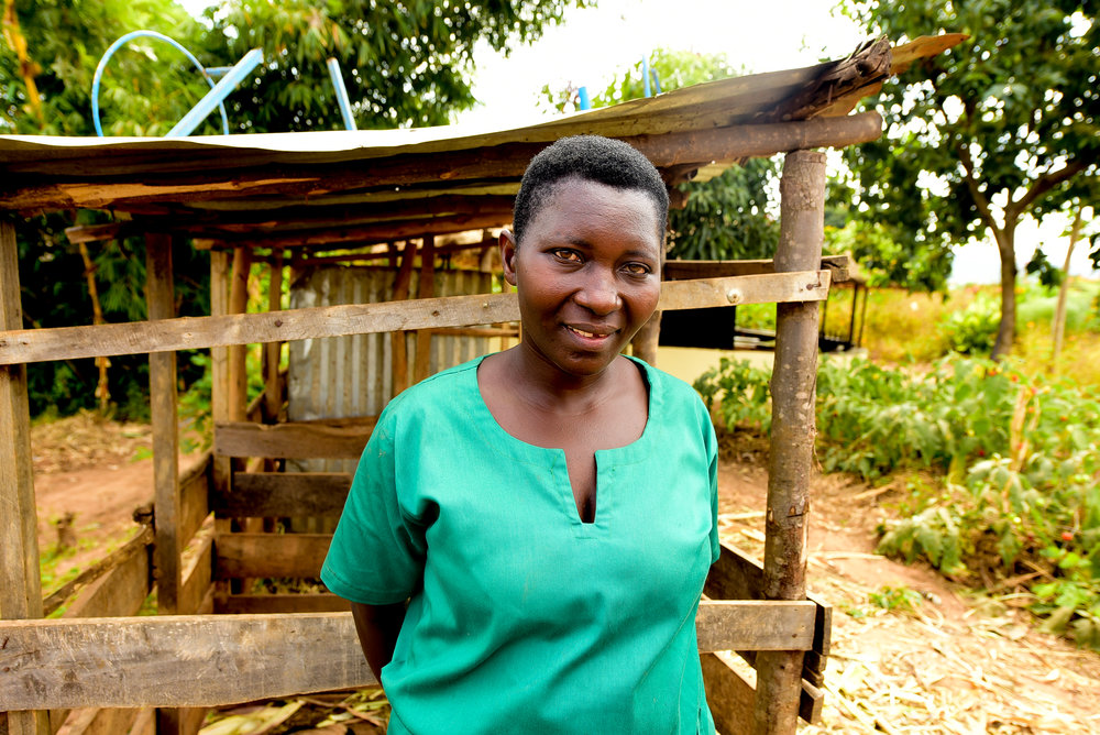 Epiphanie poses for a portrait on GHI's Ndera farm.