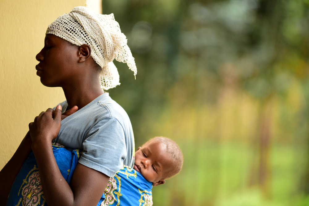 Nyirantugane Claudine, a 21-year-old mother of twin girls Uwiduhaye Divine and Muhawenimana Kevine, attends her inaugural training with Gardens for Health International, a small nonprofit organization in Rwanda that targets mothers of malnourished children for health and agriculture trainings.