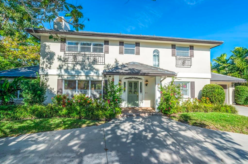 The large corner lot provides plenty of space for a circular drive out front and walking trails through the lush greenery.