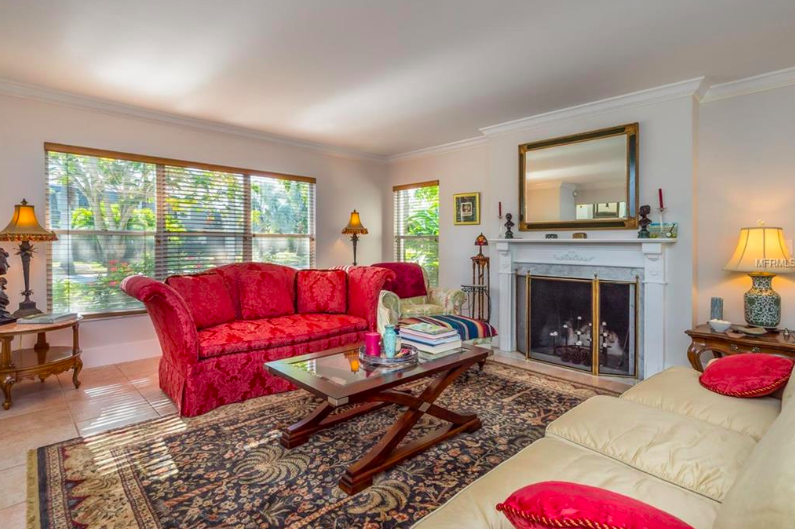 The large formal living room provides a beautiful setting for the new owners. Picture yourself cuddling up next to the fireplace with a good book on a chilly evening, or just taking in the sunlight streaming through the wide windows on a quiet, sunny afternoon.