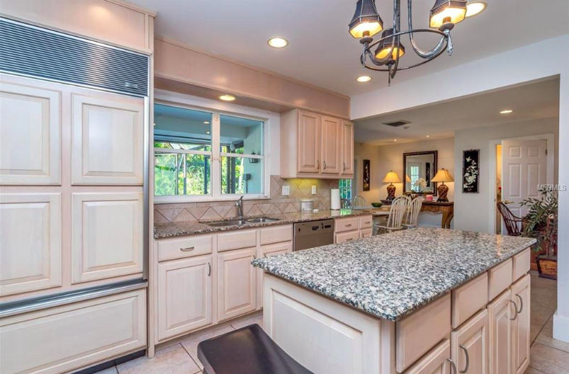 The spacious kitchen provides plenty of room for your friends and family to gather over Superbowl appetizers or cheese trays before dinner parties. Located in the center of the living space and overlooking the lanai and sparkling pool, it will be a fabulous place for the new owners to prepare their meals and enjoy their time.