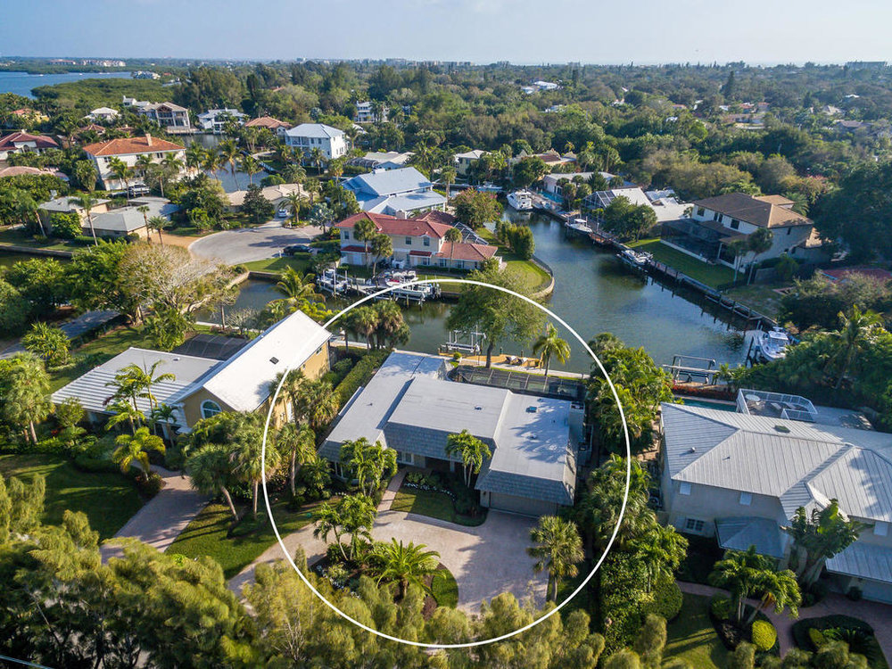 The aerial view of this home, situated on canal waters of Siesta Key.