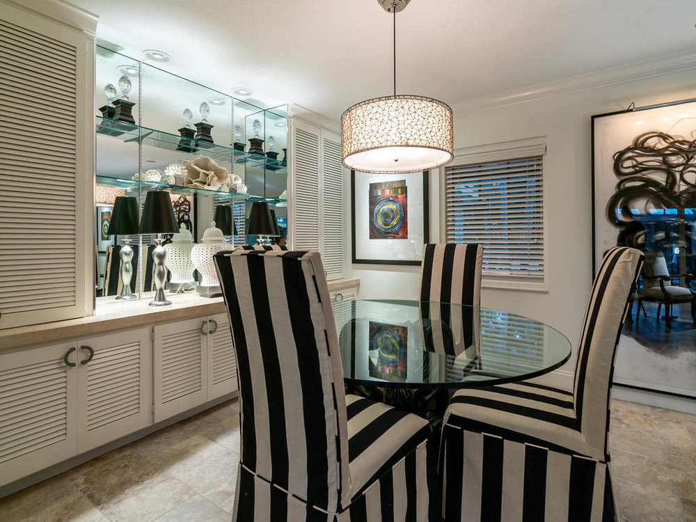Sleek built-ins and open shelving provide storage and display space in the dining area.
