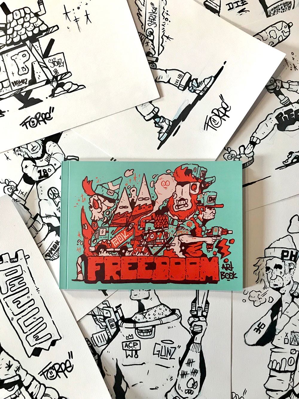 FREEdoom Artbook   A 42 page FREEDOOM art book.   This mighty book contains all the work from the  Blue period  but recoloured in the mighty technicolour hue known as green.  Learn the lingo from the Freedoom realm and discover Forpes character designs that are being used in his new comic Erol Vs Evil.   Each book is signed 1x30 & comes with stickers plus a one off artist study (the black inks shown in the background. Hurry there are only 30!