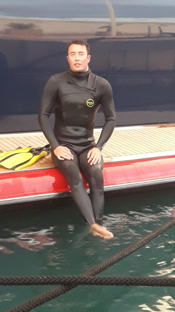 Although not cold, - The horrible condition of the water quality in Antibes Marina made Steve think that he should go fully suited.