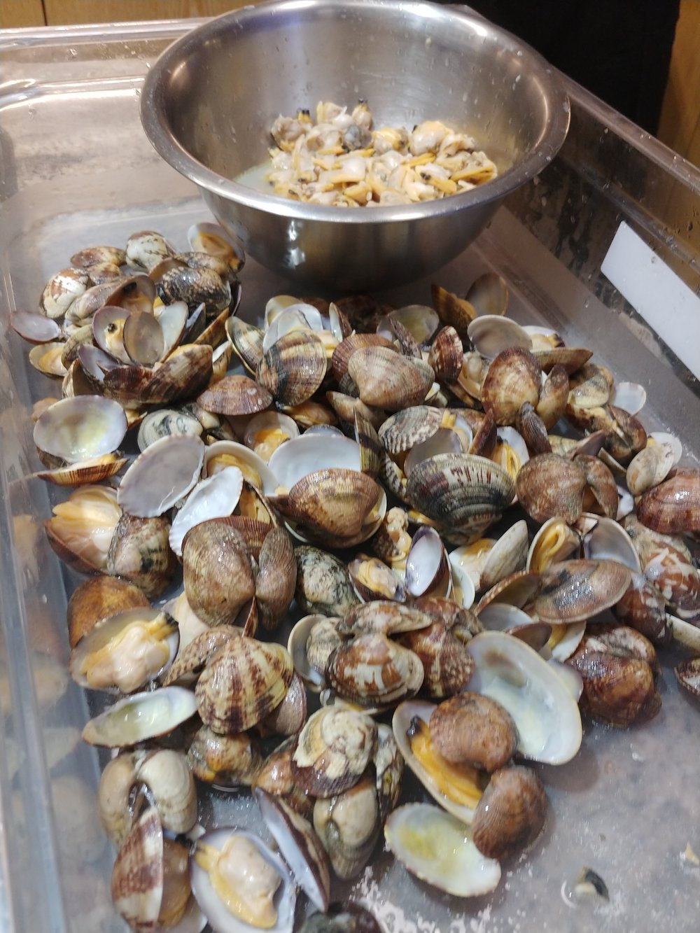 Pick - Most of the clams out of their shells. Keeping a few in shell for garnish.