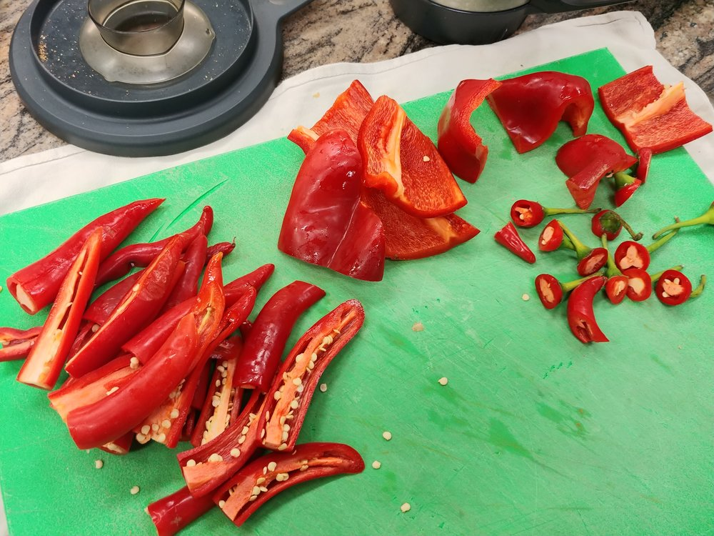 Deseed - Chilis. For a hotter curry keep some of the seeds.
