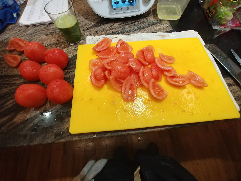 Quarter - And take the seeds out. Simply cut tomatoes into four and scoop the seeds out.