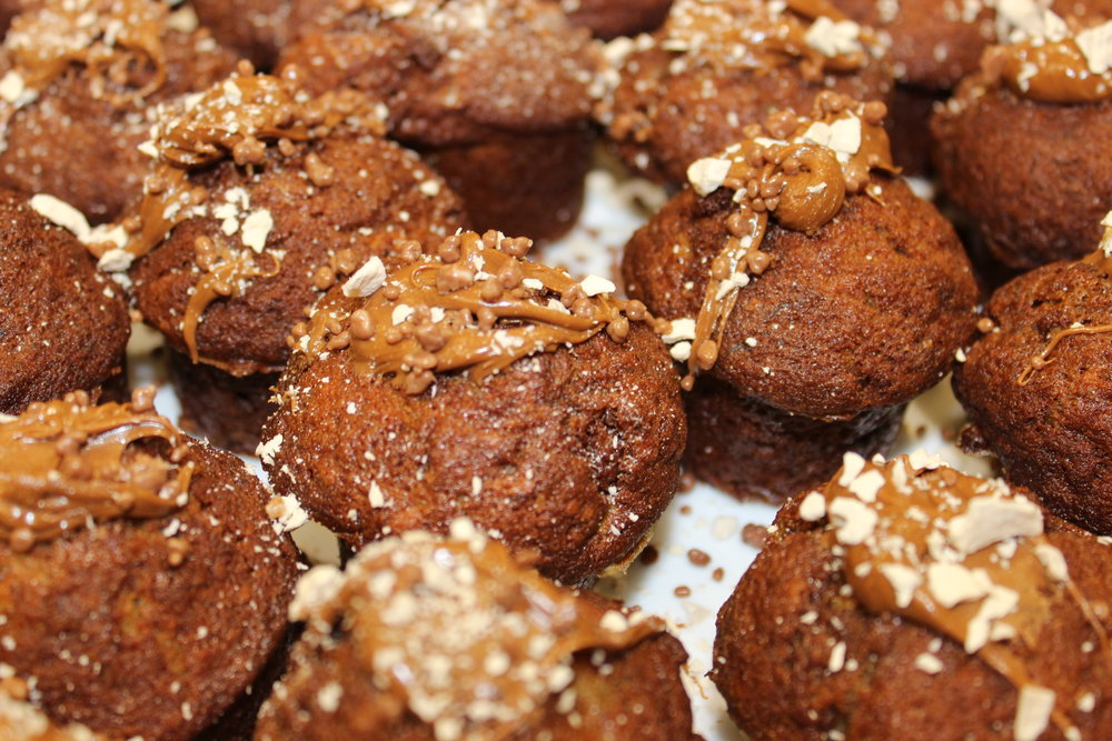 Pull - out of mould and decorate with more praline. Here, I am also using freeze dried banana and toffee bits.