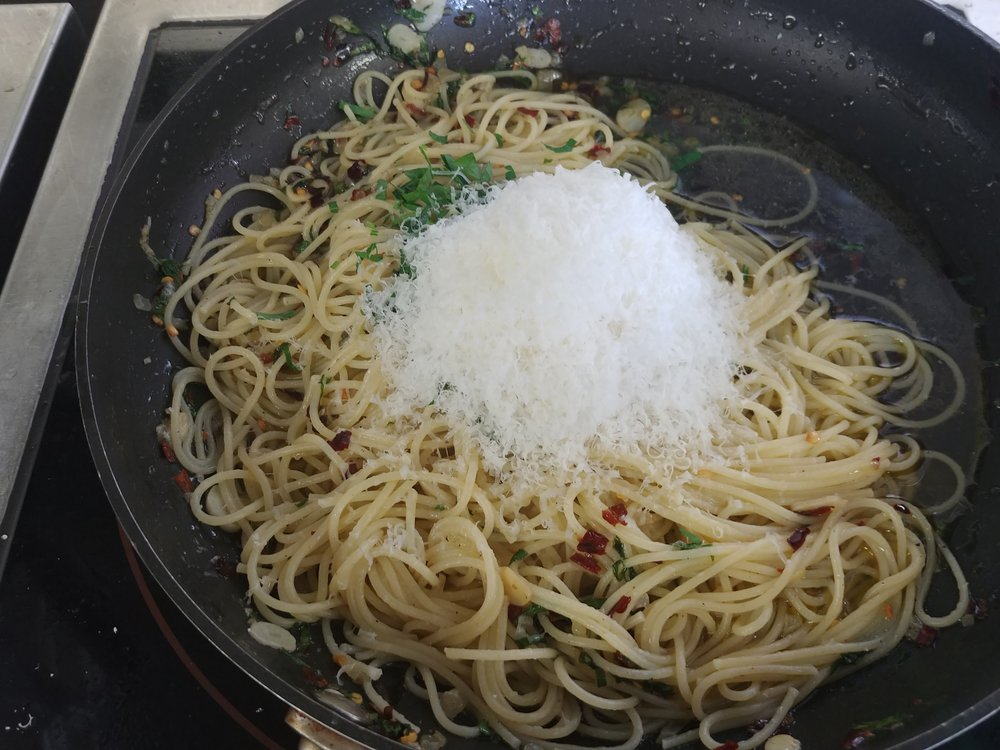 Add - the rest of the parsley and as much parmesan as you want.