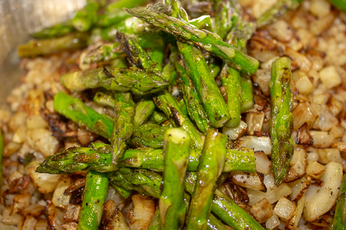 Fry - the asparagus for 2 minutes. The asparagus should be nicely coloured and still crunchy.