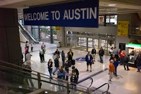 Flights to Austin TX arrive in to  Austin Bergstrom International Airport.    Please arrange flights to arrive by 2pm Thursday, February 14 to allow at least 1 hr transportation time to camp from the Austin area.