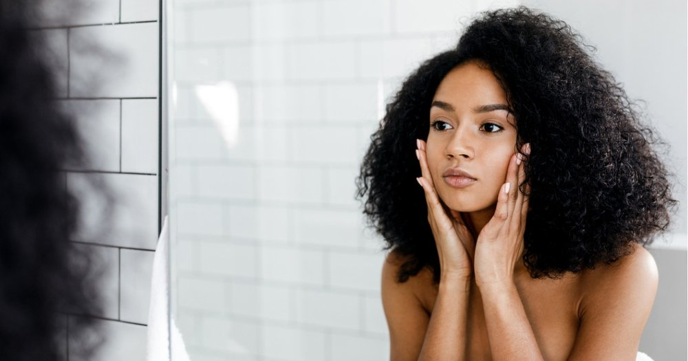 black woman washing face.jpg