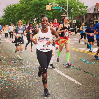 Shelby running through the District Running Collective Cheer Squad at the 2017 Brooklyn Half Marathon. Photo:  District Running Collective