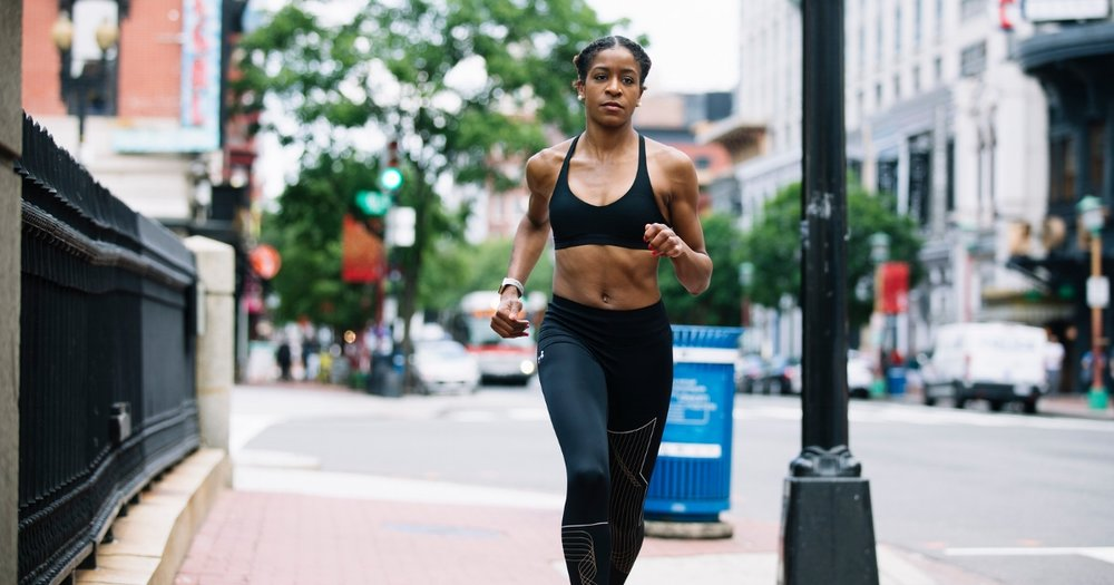 Author Brittany Henderson running through the Chinatown area of Washington, D.C. Photo: Sunchase Media for RUNGRL