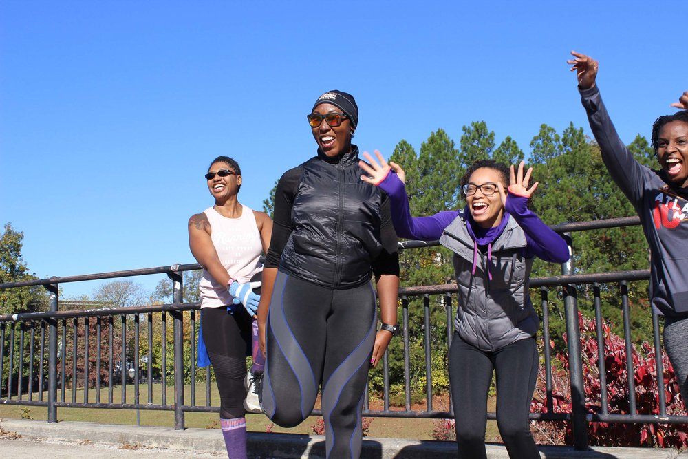 Ladies in Atlanta were excited to see one another as they warmed up for the morning run. Photo: Na'Tasha Jones for RUNGRL