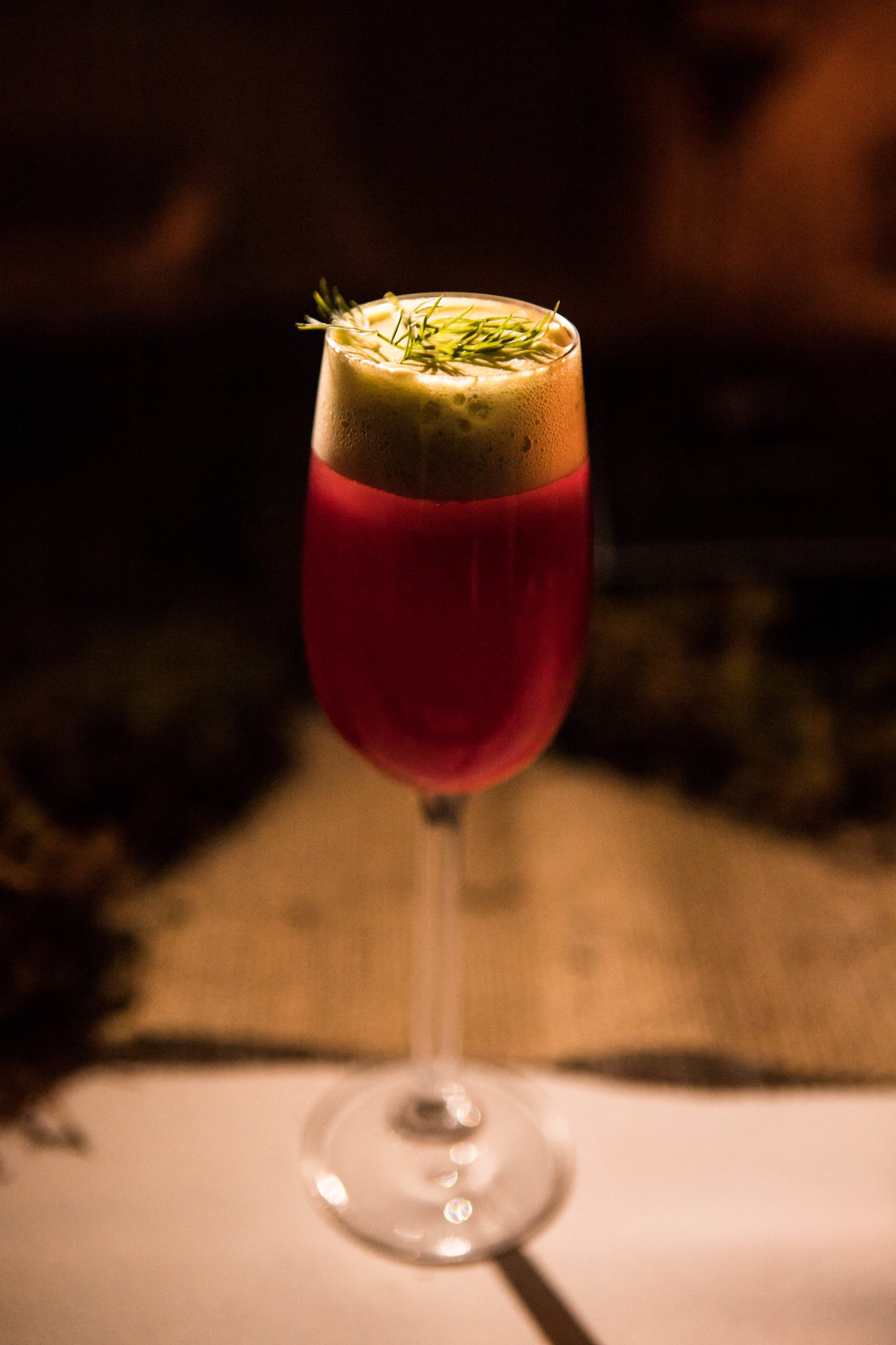 Red Beet Sour infused with Absolut, verjus, wildflower honey topped with a refreshing cucumber foam and garnished with dill.