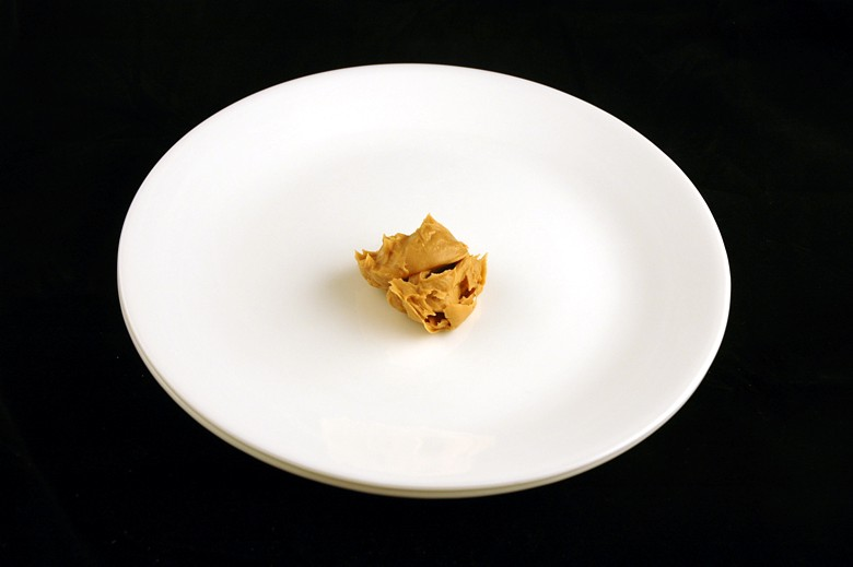 34 g of peanut butter (not natural) = 200 calories
