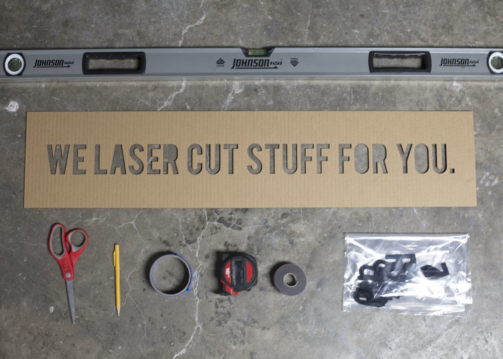 Tools needed for laser cut signage or sign installation - level, scissors, pencil, mounting tape, masking tape, laser cut sign