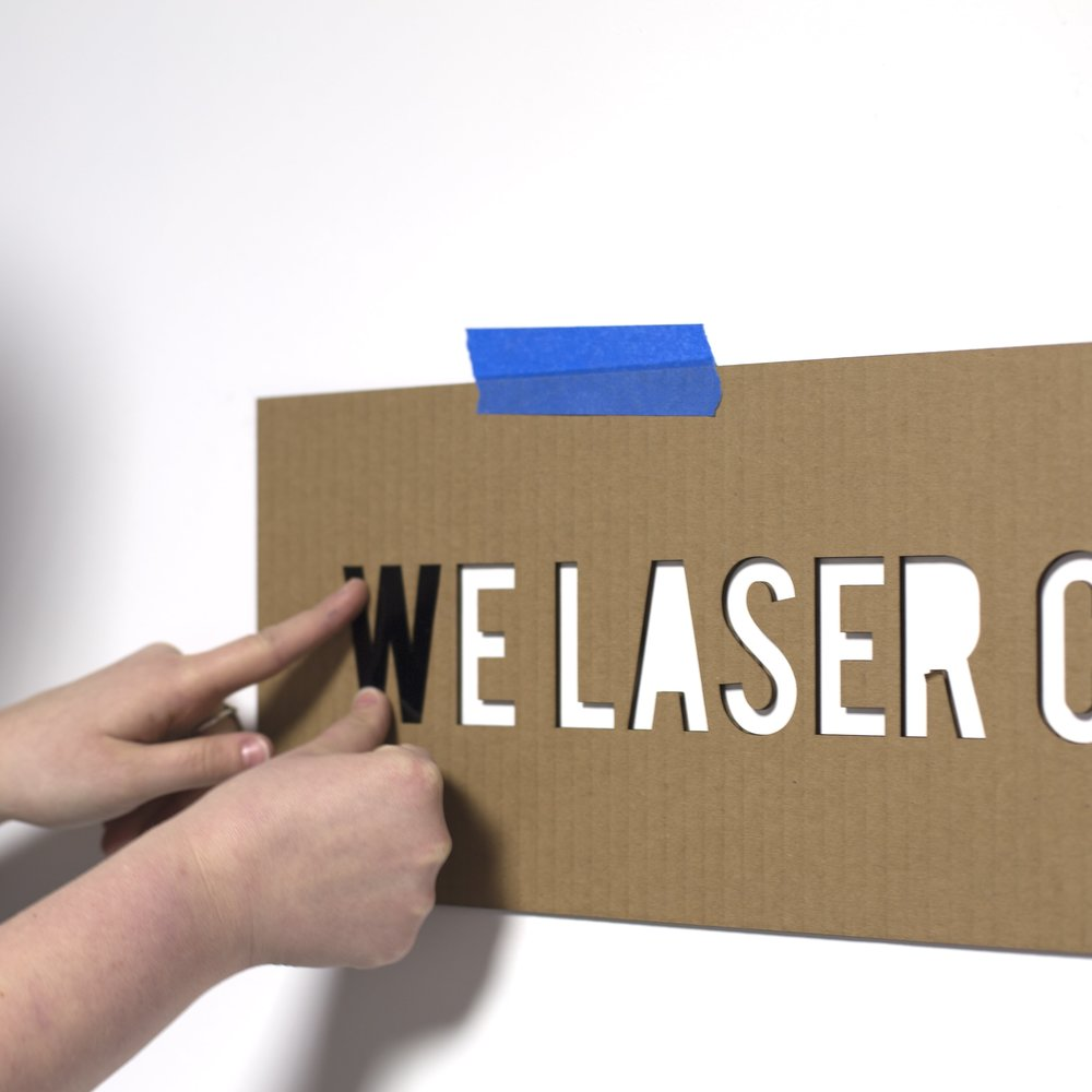 Laser Cut Cardboard template for installing acrylic sign or signage