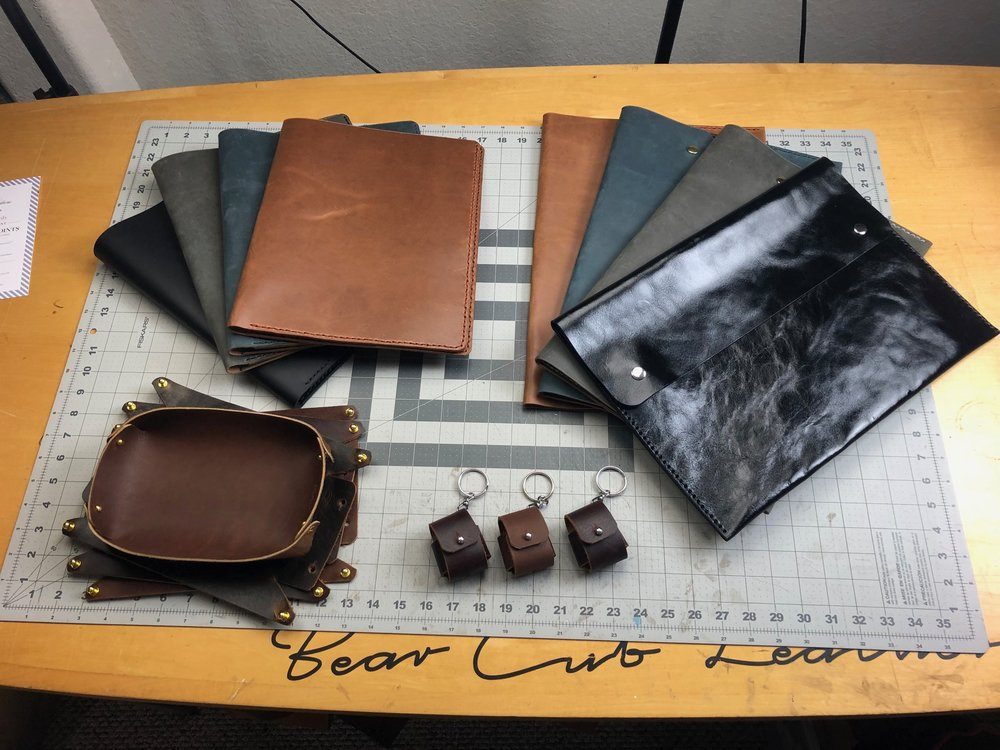 Handmade leather goods - clutches, air pod cases, valet tray
