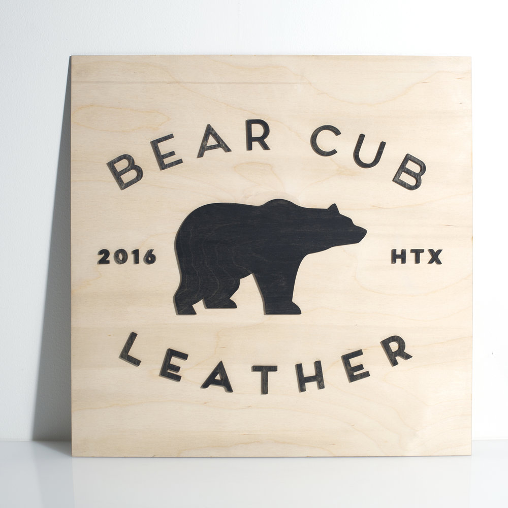 Custom Laser Cut Wood Sign with Natural Plywood and Stained Black Plywood for Bear Cub Leather in Houston, TX