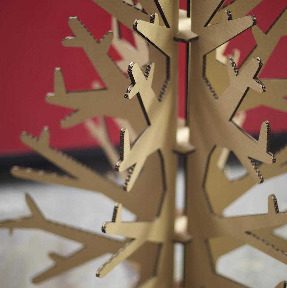 Laser Cut Cardboard Christmas Tree in Front of Lasercutter