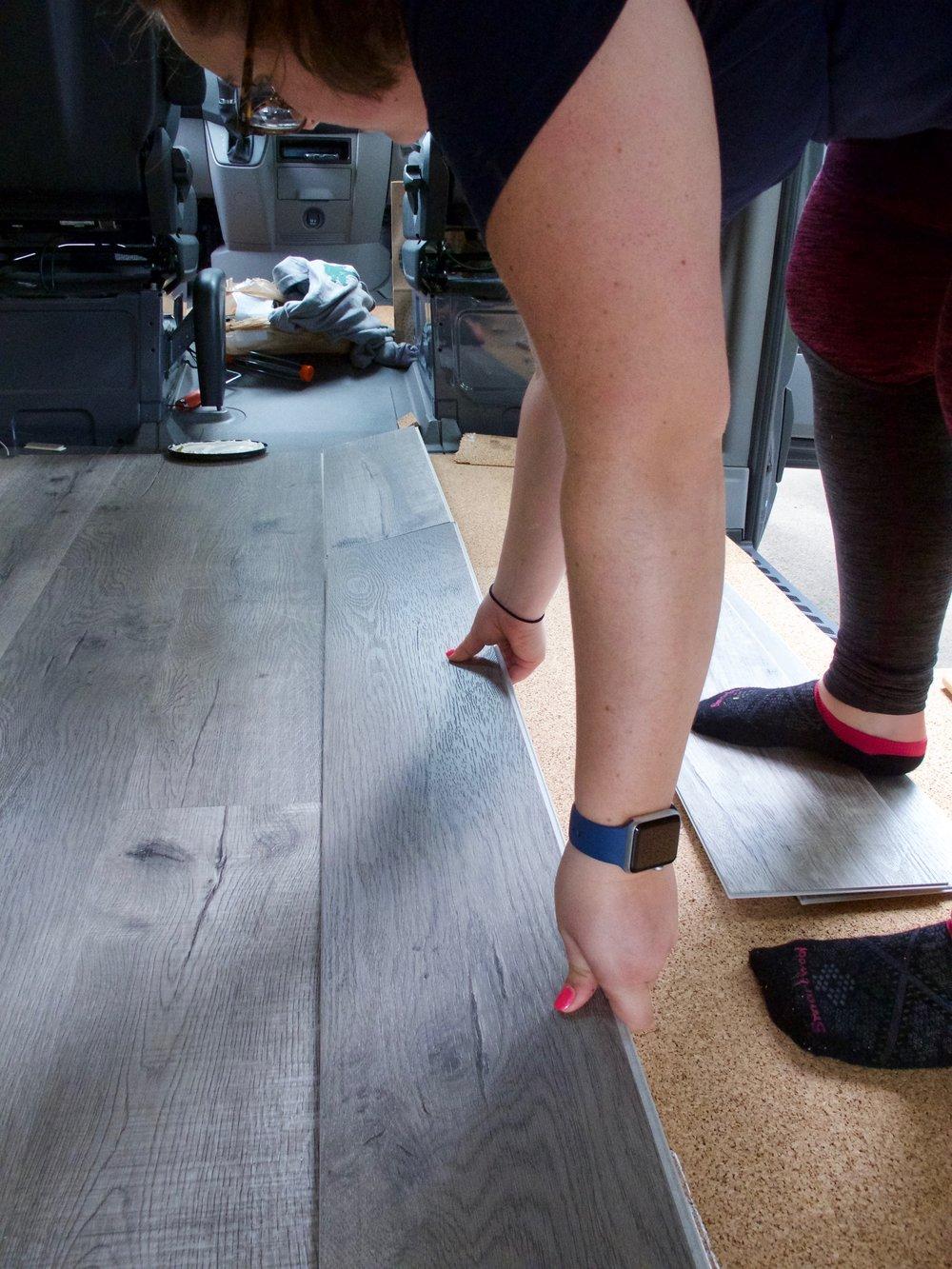 rebecca laying flooring.jpg