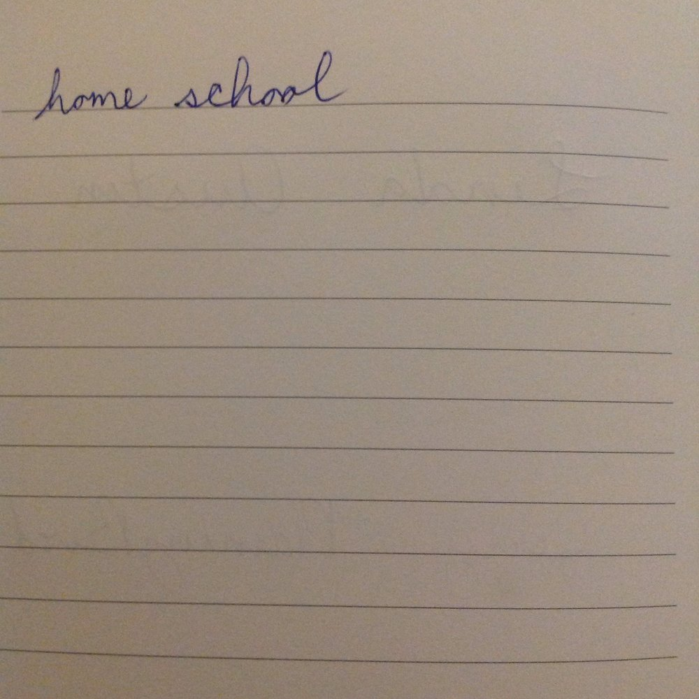 """visual description: a photo of lined paper with the words """"home school"""" written on it"""