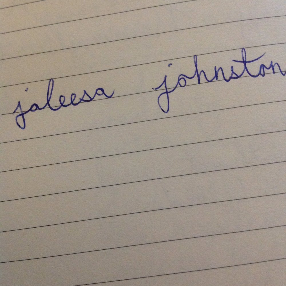 """visual description: a photo of lined paper with the words """"Jaleesa Johnston"""" written on it"""