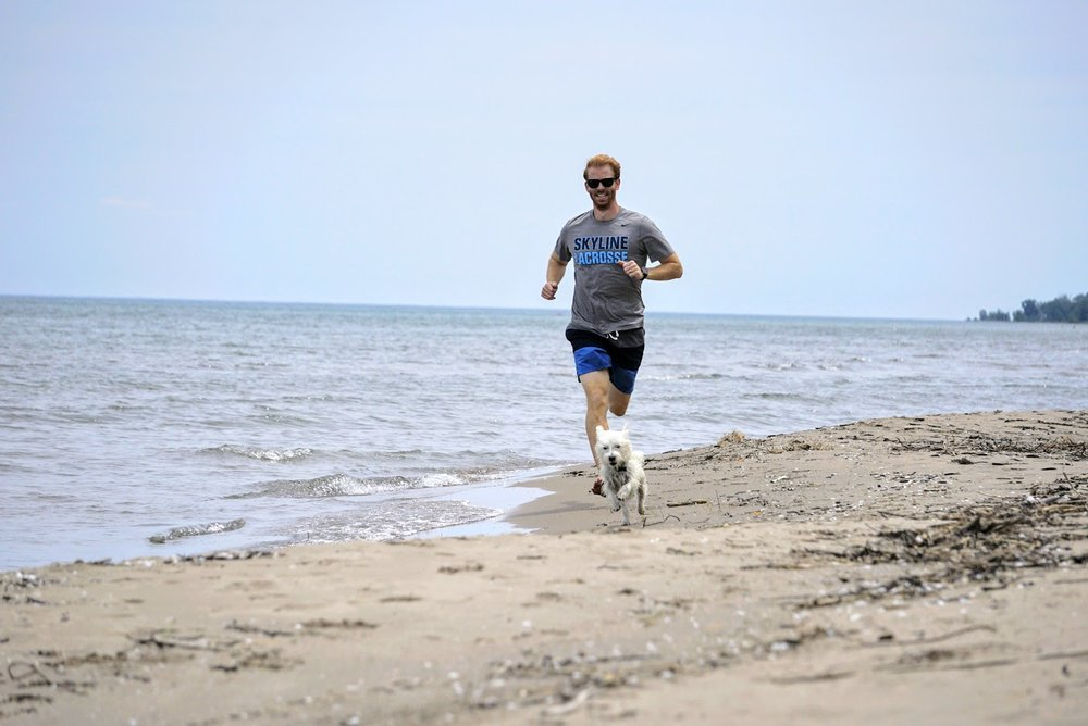 Jack and Welly running along Lake Erie in 2017