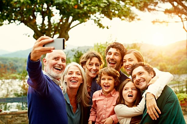Cheerful-family-taking-selfie.jpg