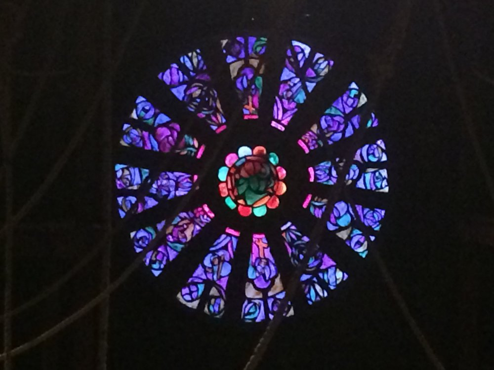 Stained glass window painted with handmade transcluscent paints, backlit with LED strip lights.