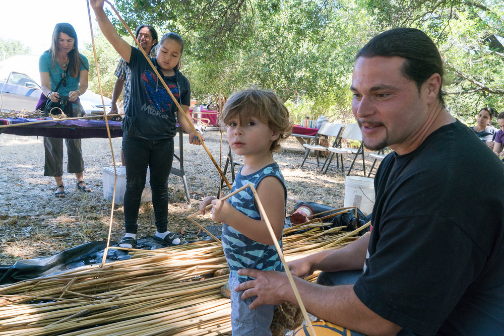 Ben Shleffer—who teaches about soaproot and manzanita in this episode—weaving tule with his son.