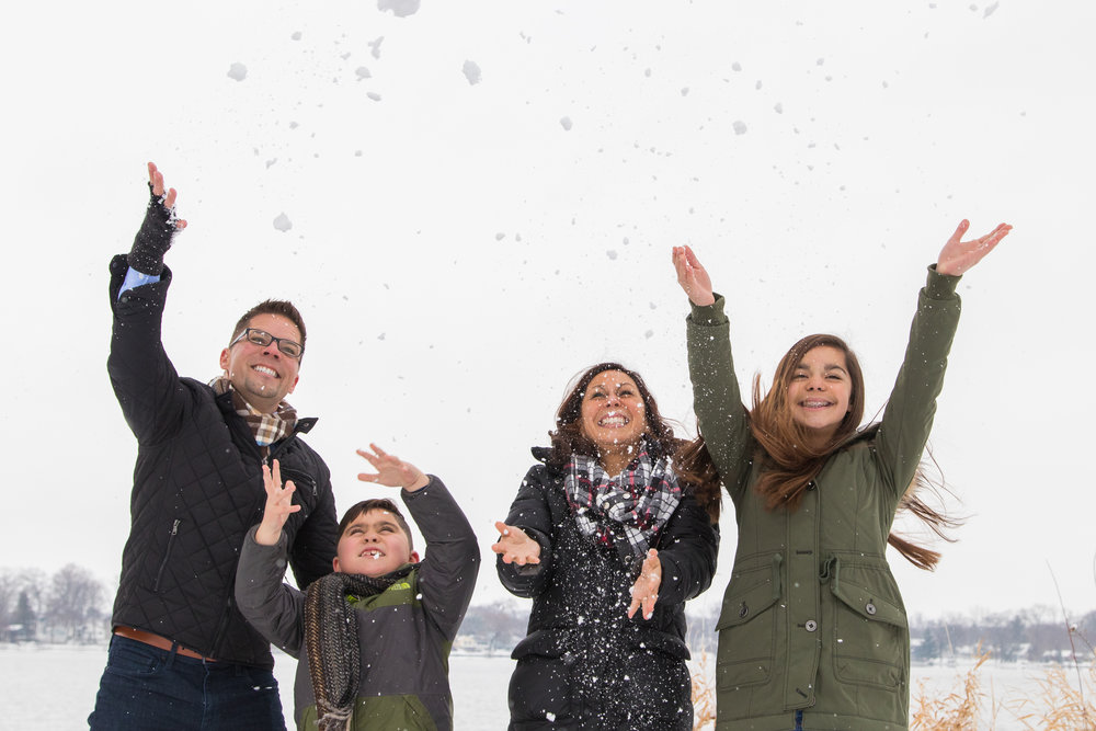 Family Tossing up Snow