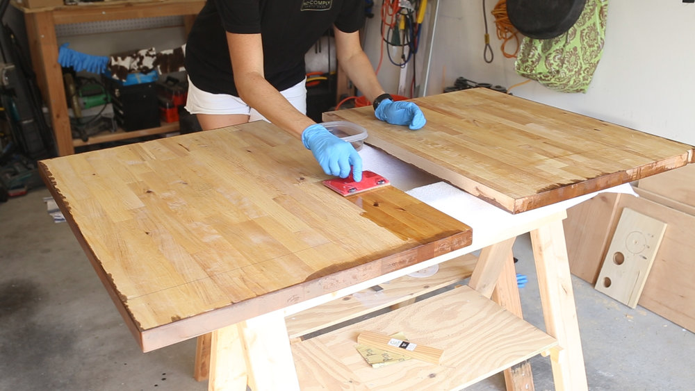 I started by sealing the bottoms and sides with two coats of the Waterlox Original, letting them dry for 24 hours in between coats. I started by using a paint pad but ultimately ditched that and just used a good quality paint brush for the tops.