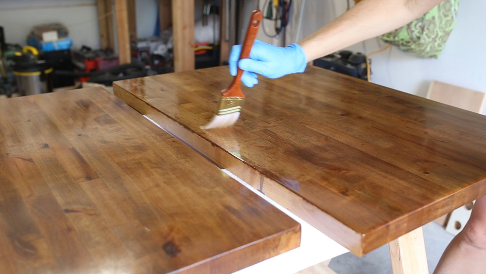 The tops needed more protection than the bottom. I started this step by applying two coats of Waterlox Original, with 24 hours of drying in between. I also sanded each coat before applying the next with a piece of super fine steel wool.