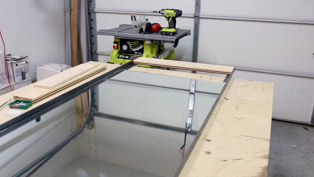 I then slid in the mirror and placed it in the dado (groove) in the wood end.